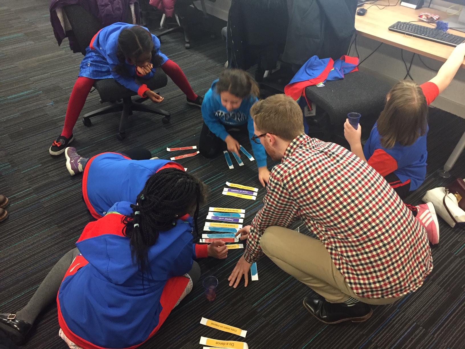 Jonny Jackson interacting with five students