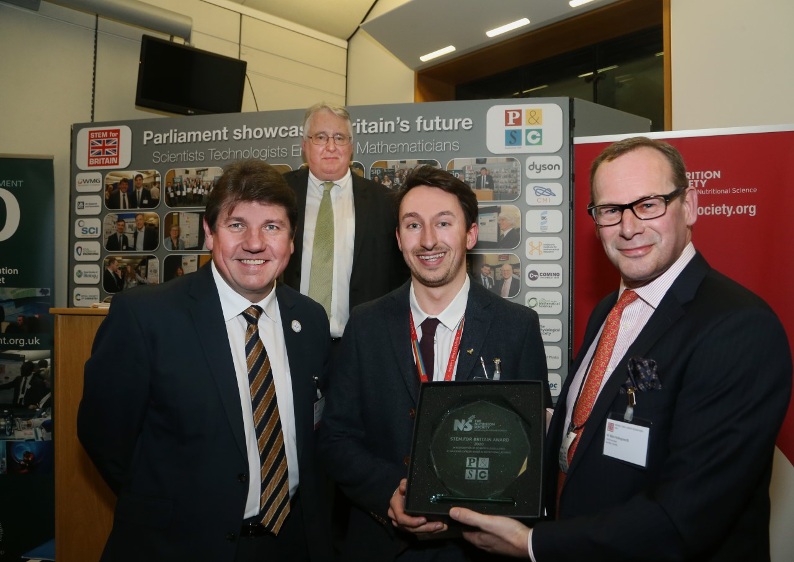 STEM for Britain Nutritional Society Prize Award photo. From left to right; Stephen Metcalfe MP, Chair of the Parliamentary and Scientific Committee, Dr Stephen Benn, Director of Parliamentary Affairs at the RSB, George Firth, Mark Hollingsworth, CEO of the Nutritional Society